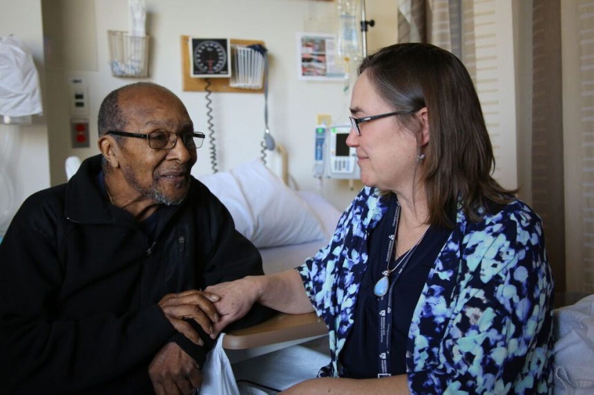 From left: Patient Thaddeus Pritchard with Catherine Arnold, MSW, LICSW, medical social worker