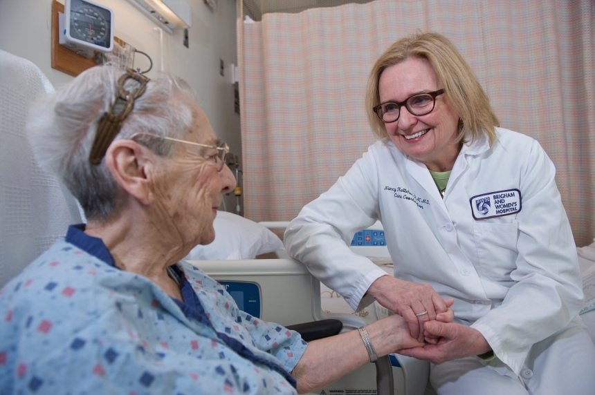Nancy Kelleher, MSN, RN, connects with a patient about plans for discharge