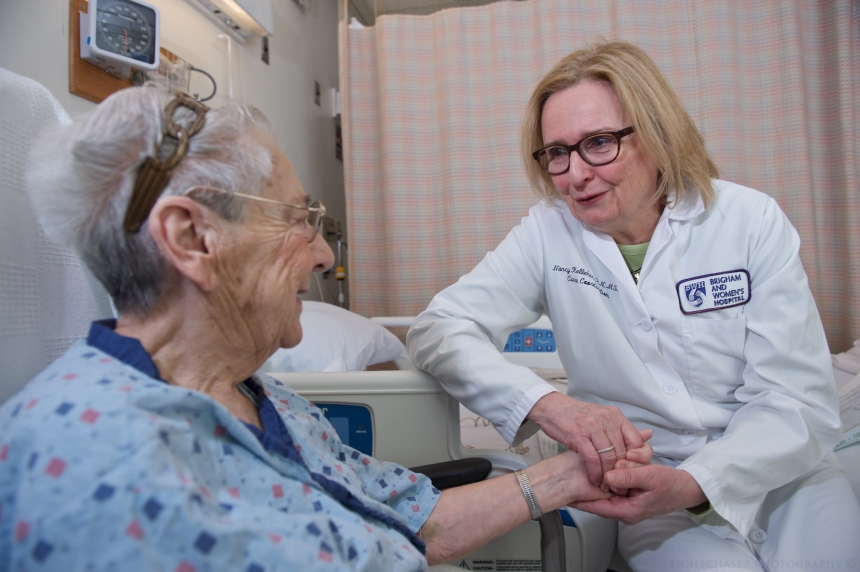 Nancy Kelleher, MSN, RN, recipient of the 2016 Essence of Nursing Award, cares for a patient.