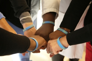 "Members of the 15CD clinical practice council show their ""Allowing for Miracles"" bracelets."