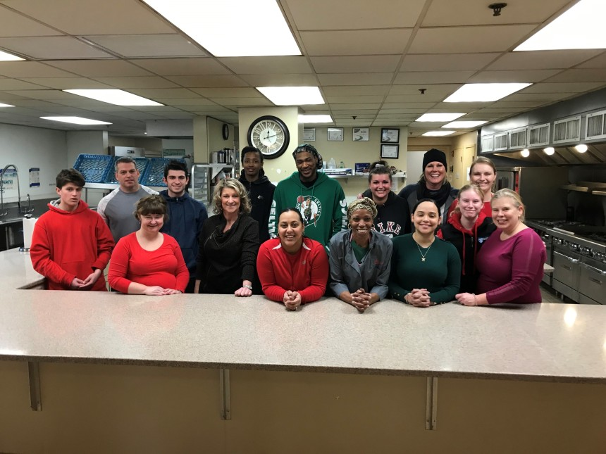 Staff and family members volunteer to serve lunch at Rosie's Place.